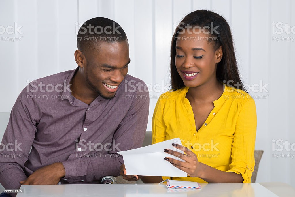 Young Couple Reading Letter stock photo