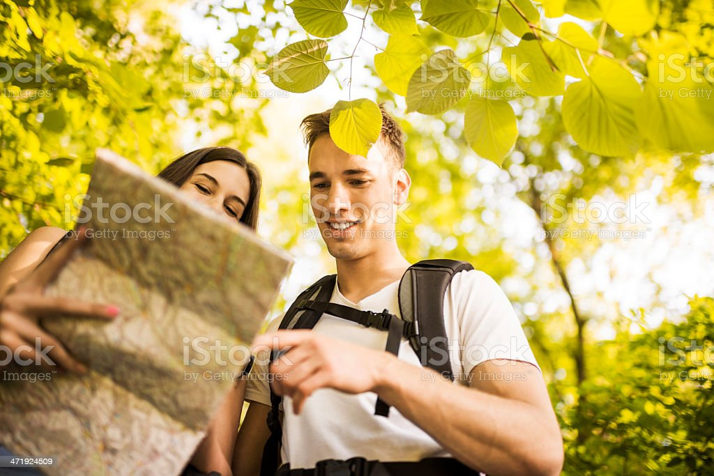 Young couple reading map together. royalty-free stock photo