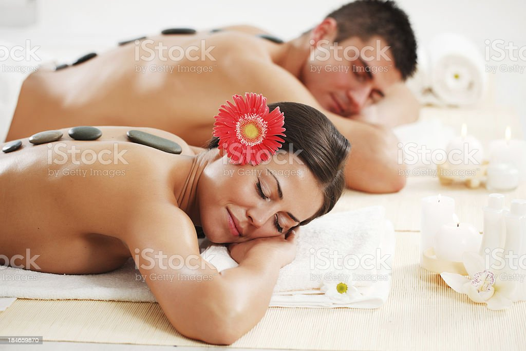 Young couple receiving a hot stone therapy royalty-free stock photo