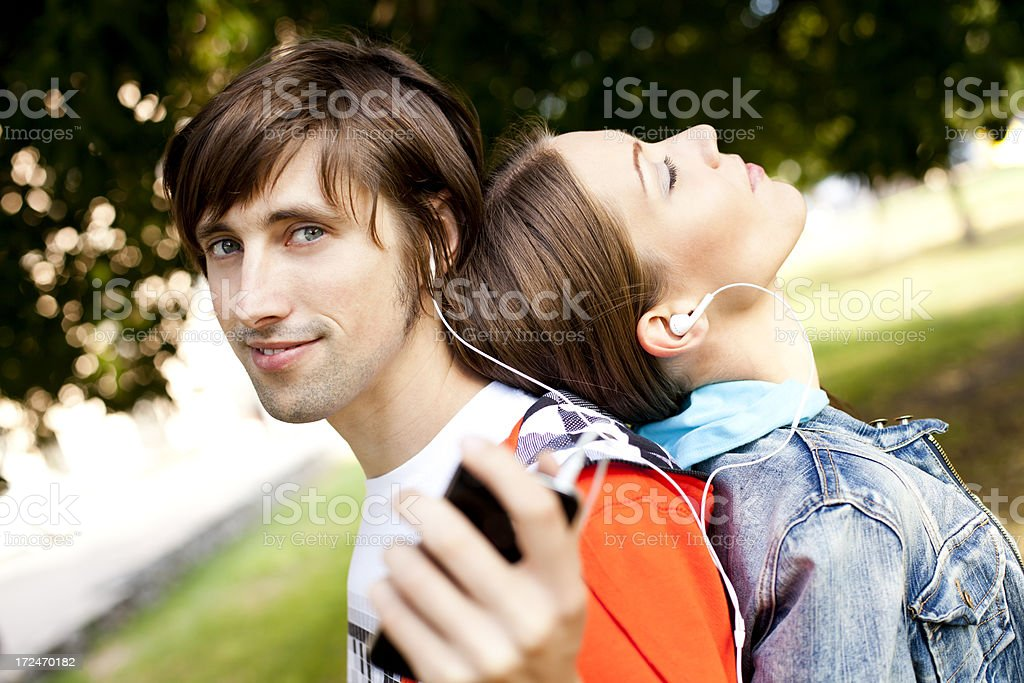 Young Couple Relaxing At Park royalty-free stock photo
