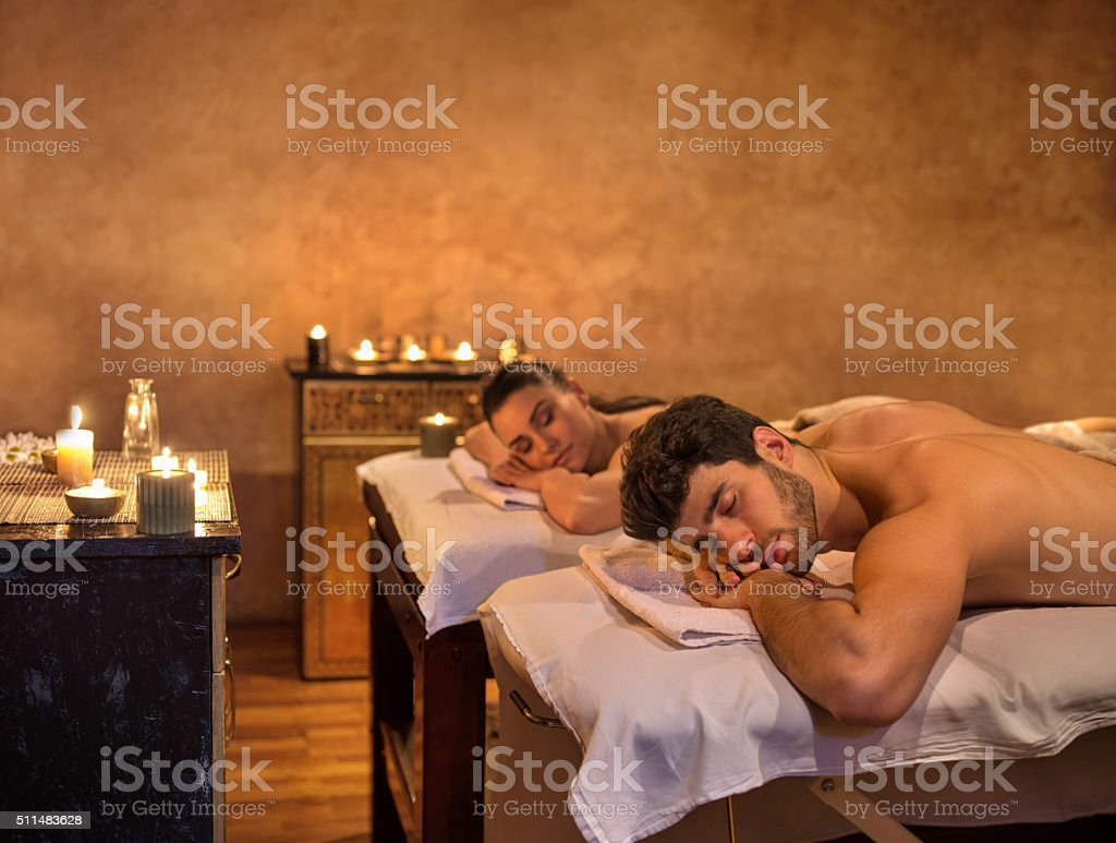 Young couple relaxing at the spa. stock photo