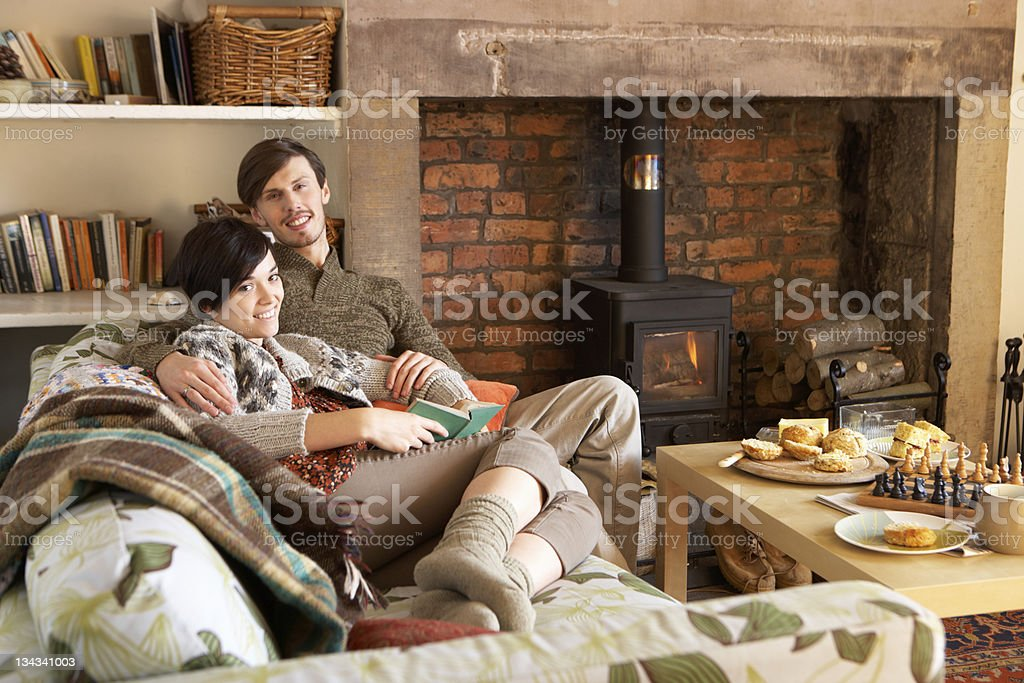 Young couple relaxing by fire royalty-free stock photo