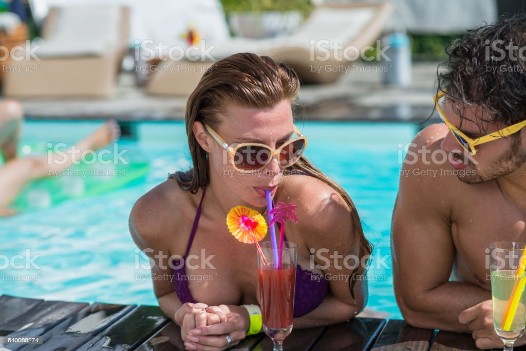 Young Couple Relaxing In Swimming Pool stock photo