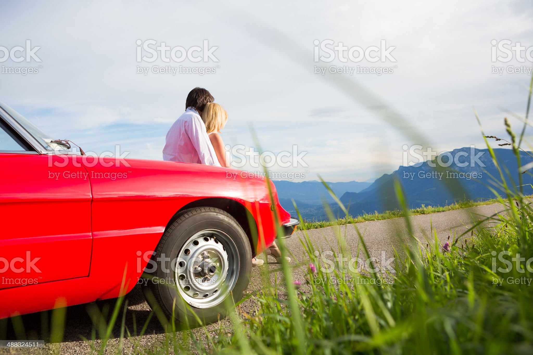 Young couple relaxing on a cabriolet royalty-free stock photo