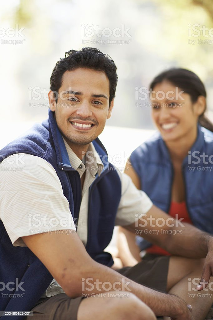 Young couple relaxing on blanket after hike stock photo