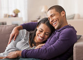 Young couple relaxing together on couch