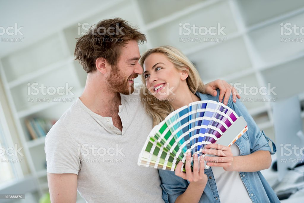 Young couple remodeling their house stock photo