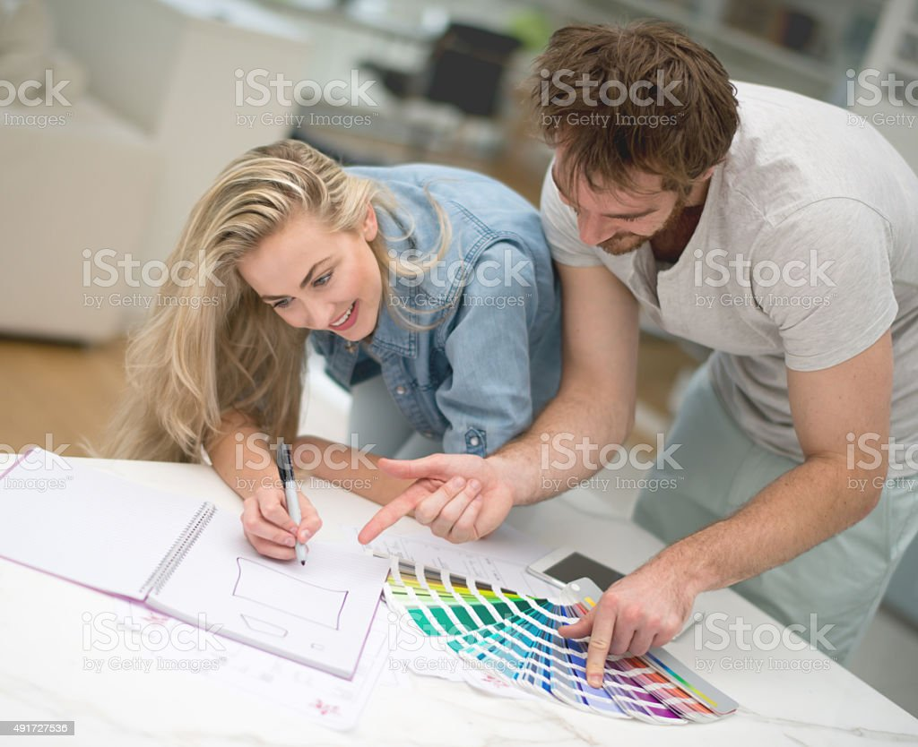 Young couple remodelling their house stock photo