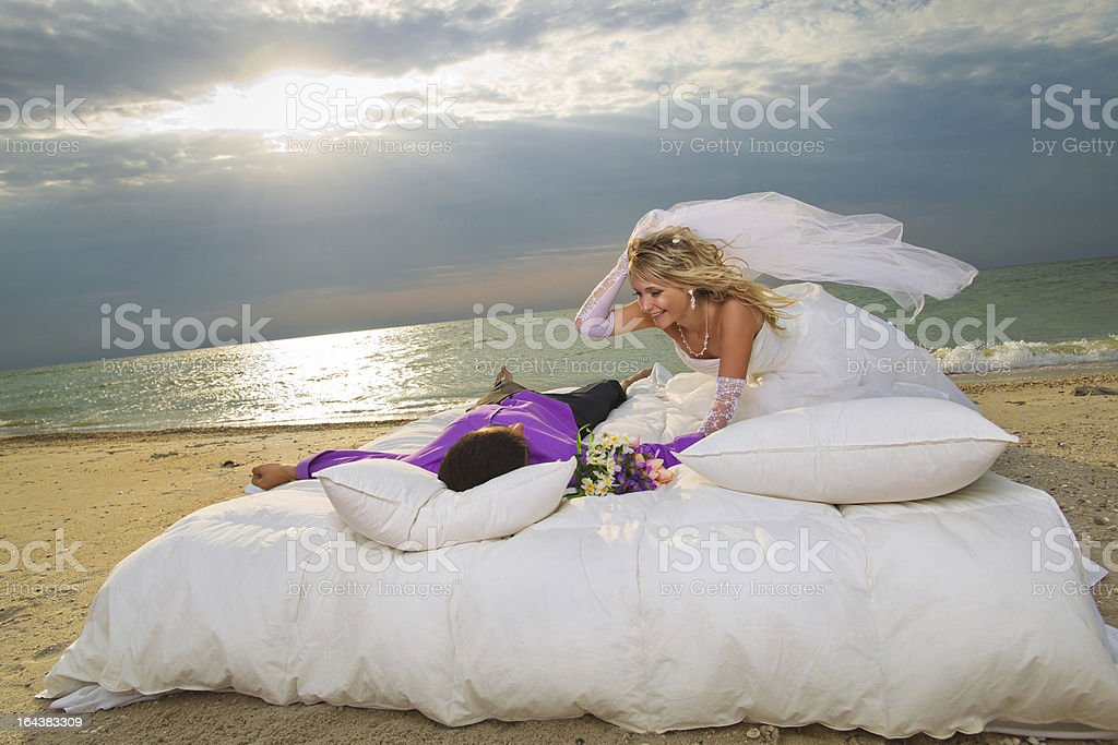 Young couple resting in bed royalty-free stock photo