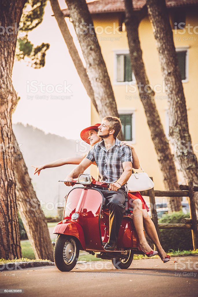 Young Couple Riding a Vintage Scooter stock photo