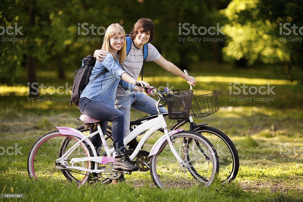 Young couple riding bicycle. royalty-free stock photo