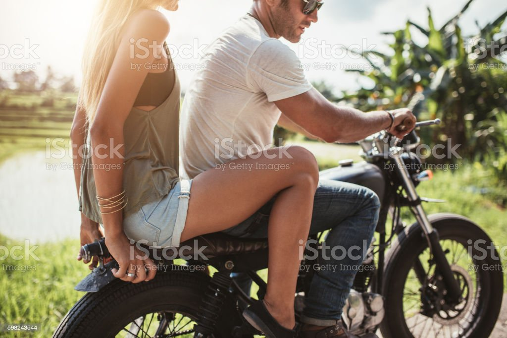Young couple riding on a motorcycle stock photo