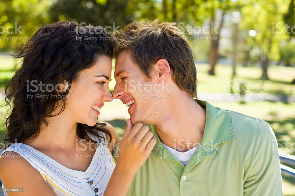 Young couple romancing at park royalty-free stock photo