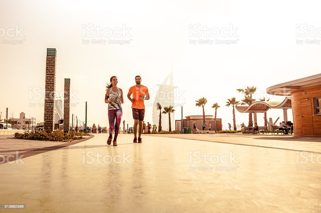 Young couple running - Fitness and exercising in Dubai stock photo