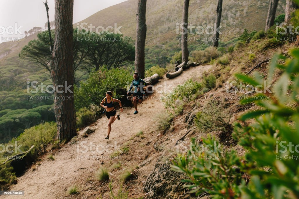 Young couple running in nature stock photo