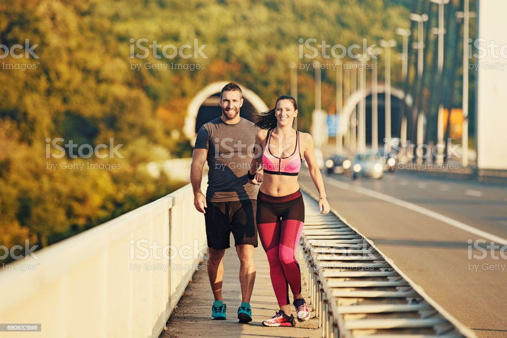 Young Couple Running on the Bridge stock photo
