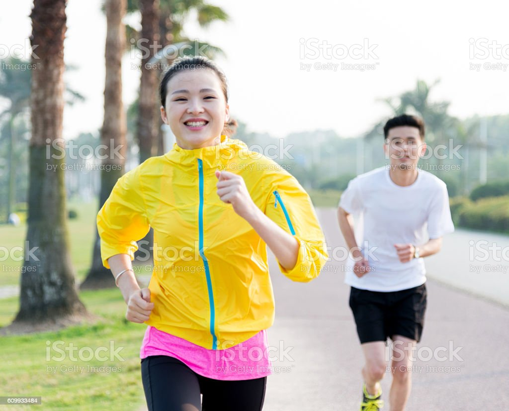 Young couple running together stock photo