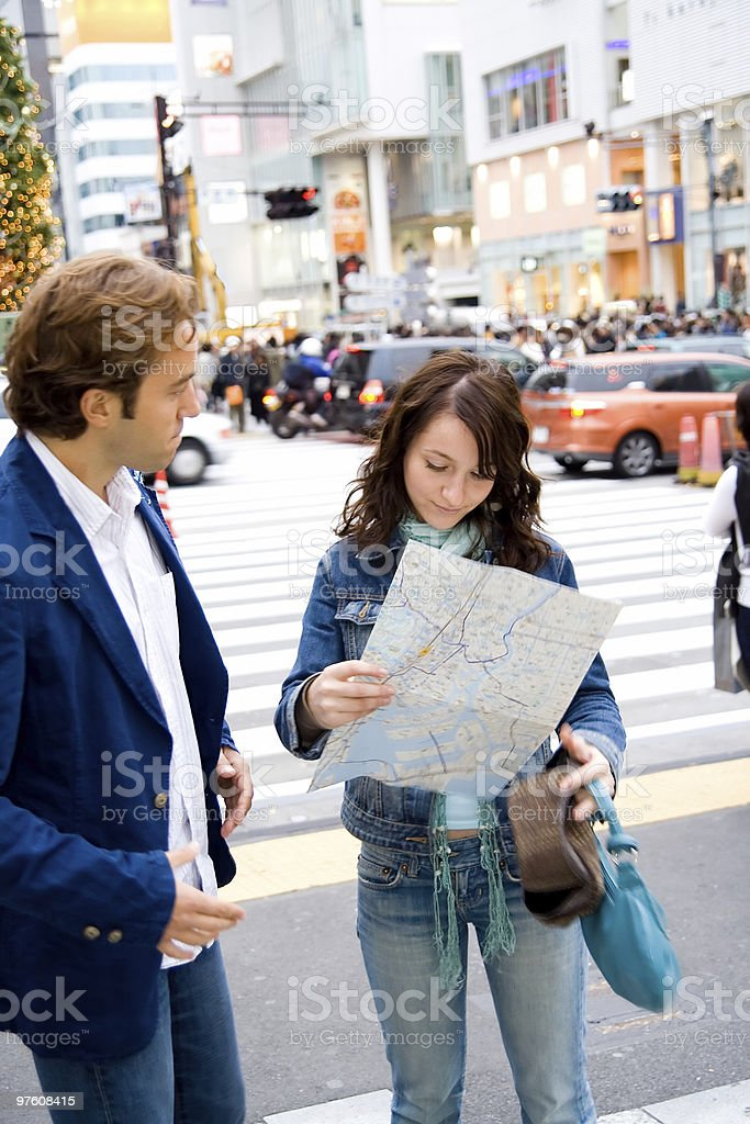 Young couple searching for directions royalty-free stock photo