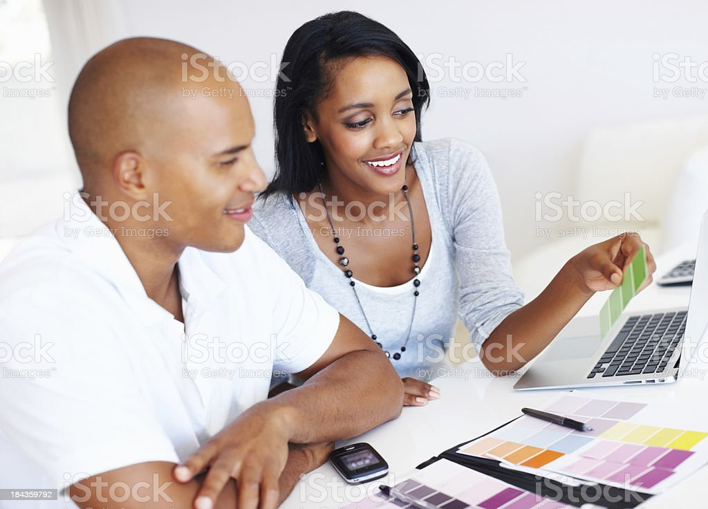 Young couple selecting color for their house royalty-free stock photo