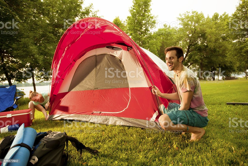 Young Couple Setting up Tent in Campsite royalty-free stock photo