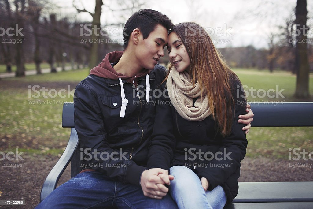 Young couple sharing a tender moment stock photo