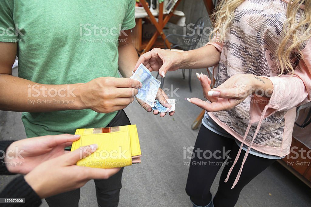 young couple shop and bargain at outdoor market stall royalty-free stock photo