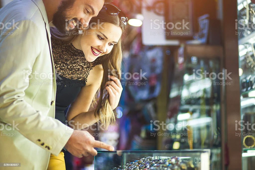 Young couple shopping at the street bazaar stock photo