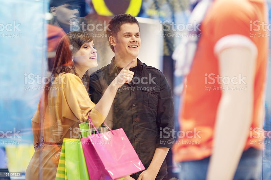 A young couple shopping for clothes royalty-free stock photo