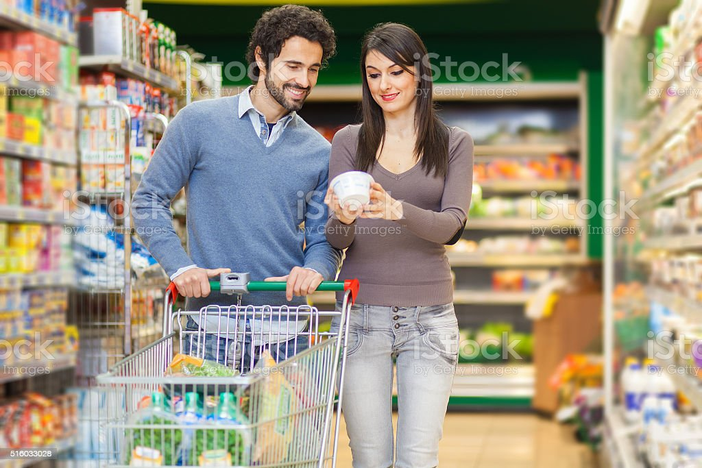 Young couple shopping in a supermarket stock photo