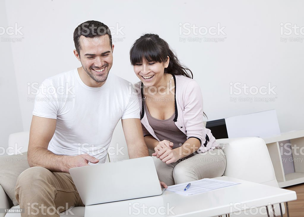 Young couple shopping in internet royalty-free stock photo