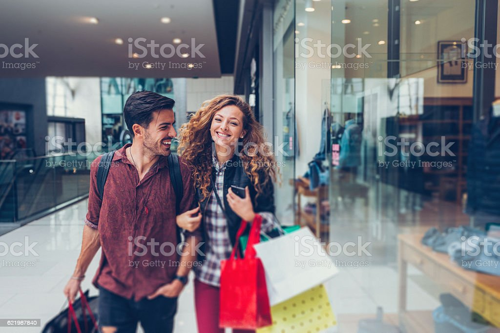 Young couple shopping in the mall stock photo