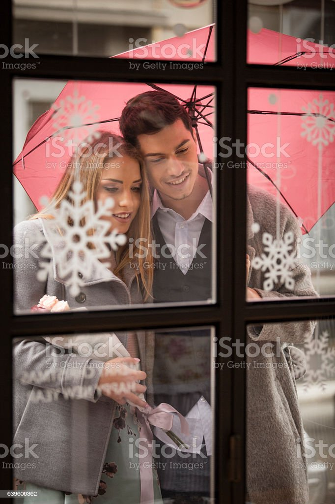 Young couple shopping on a rainy day stock photo