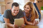 Young couple shopping online for their new home