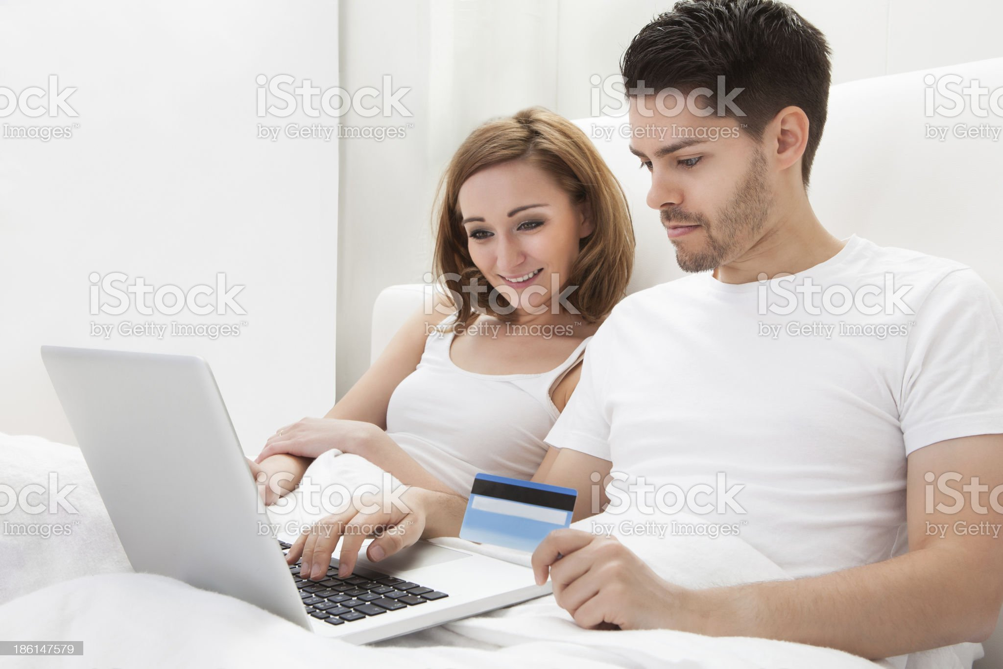 Young couple shopping online royalty-free stock photo