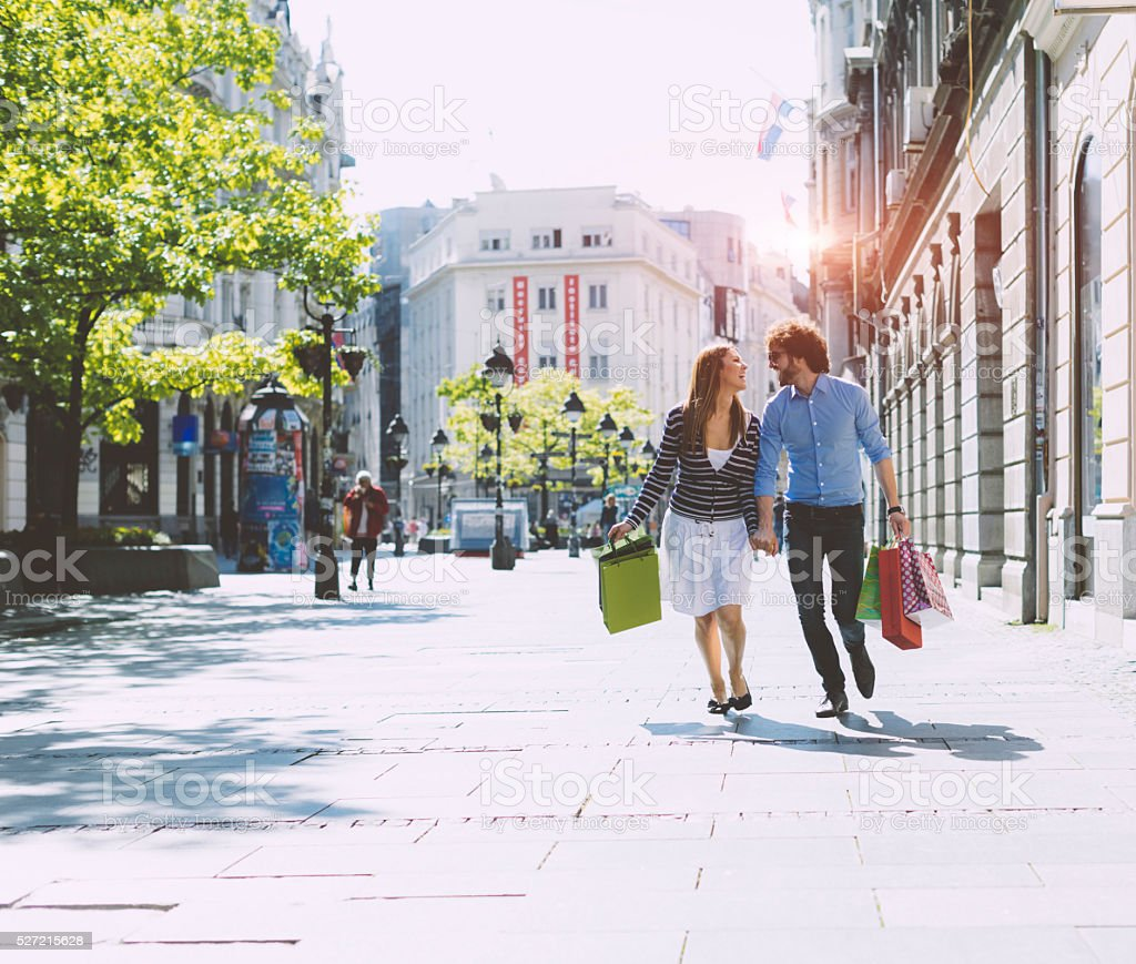 Young Couple Shopping Together in a City. stock photo