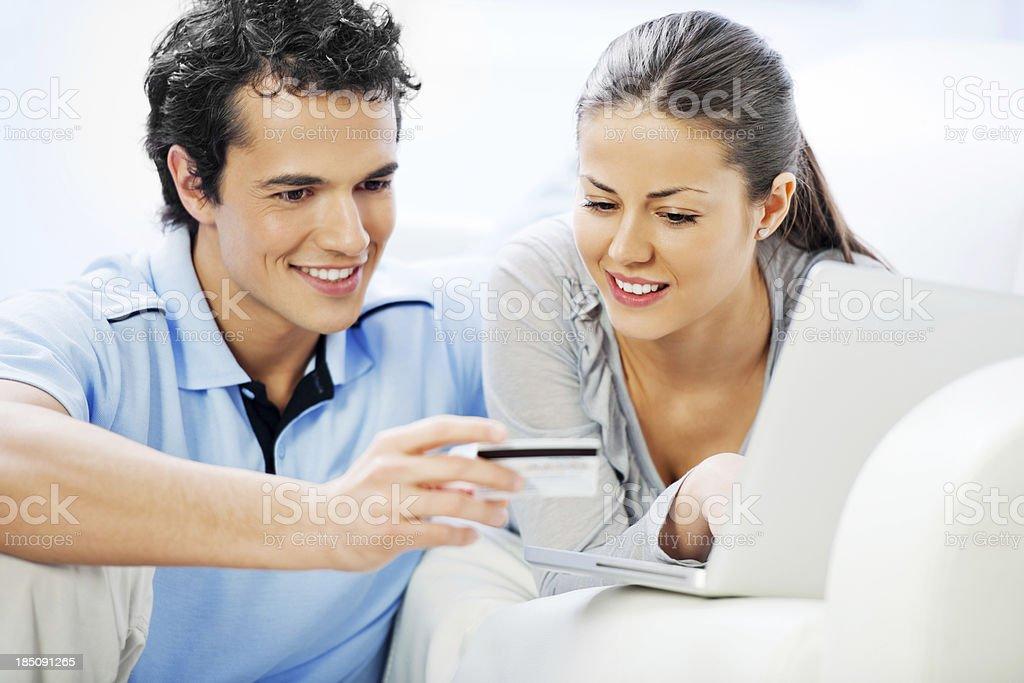 Young couple shopping via internet. royalty-free stock photo
