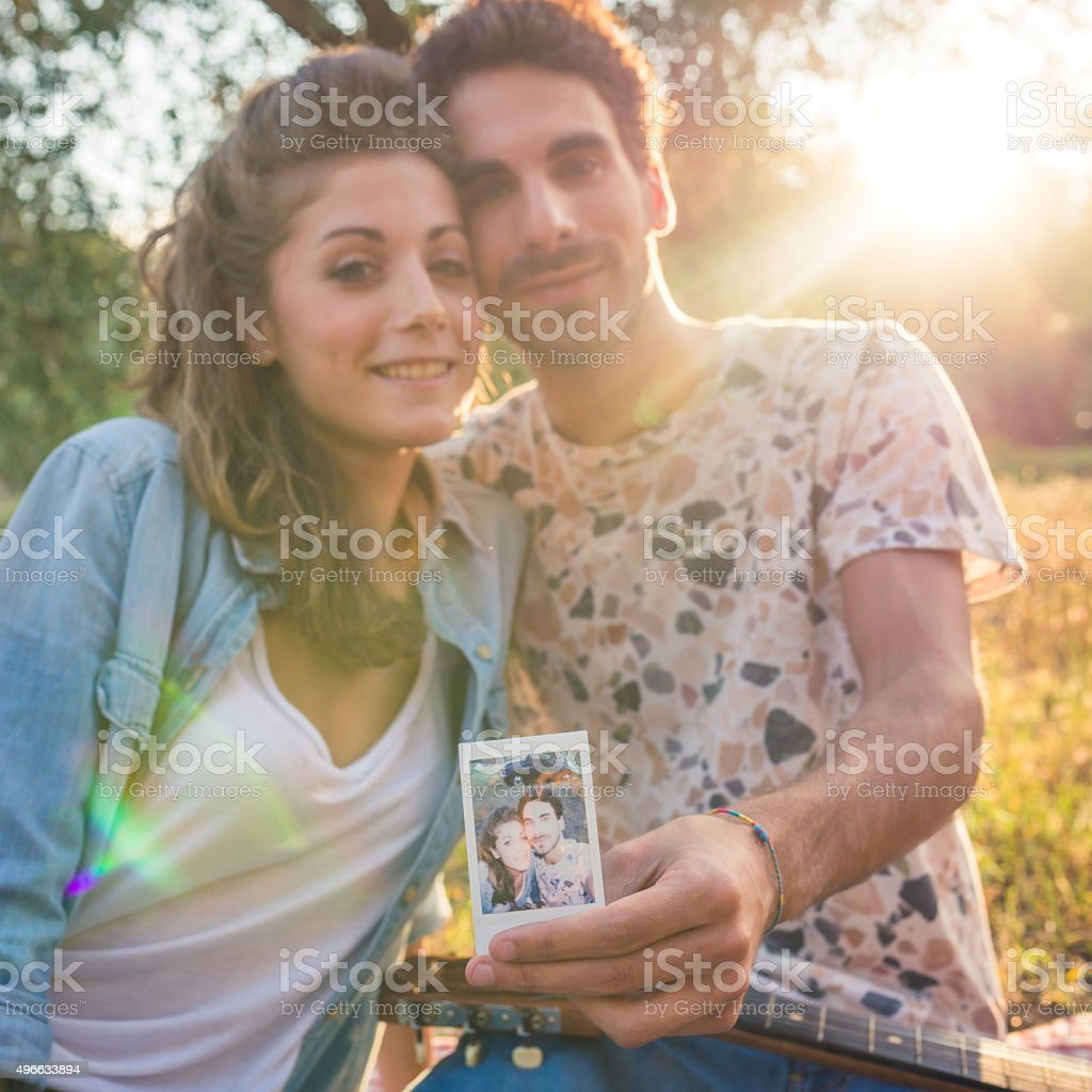 Young Couple Showing A Vintage Selfie Photo stock photo