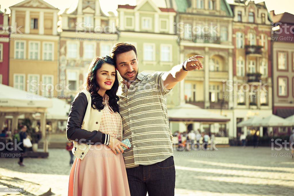 Young couple sightseeing european old town stock photo