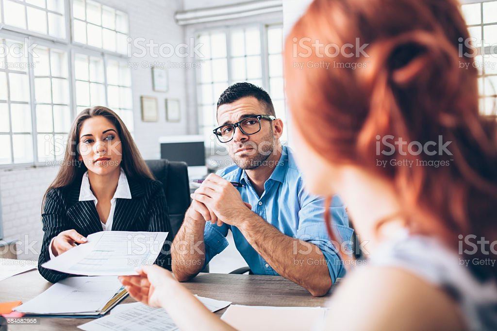 Young couple signing contract stock photo