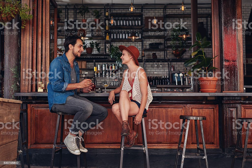 Young couple sitting at cafe counter stock photo