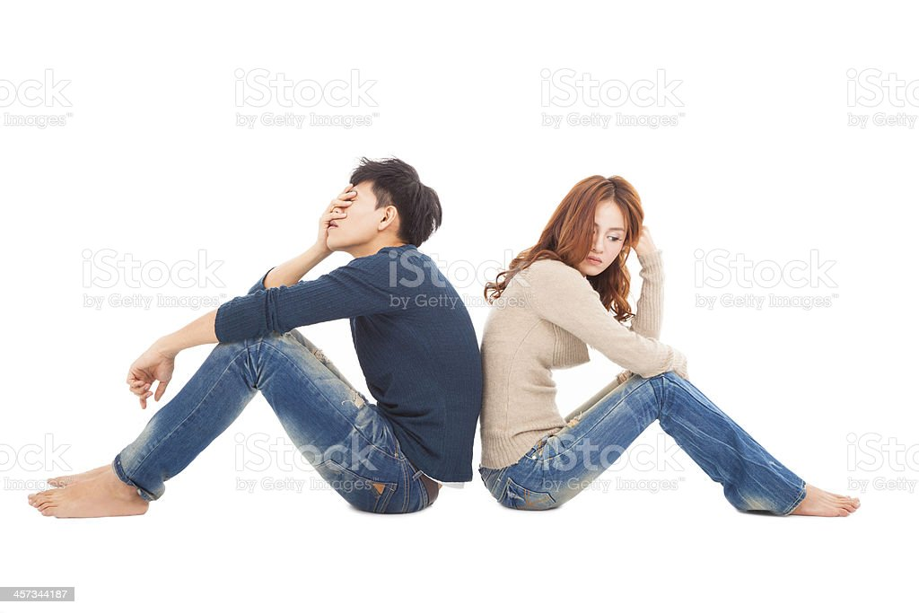 young Couple sitting back  during  conflict royalty-free stock photo