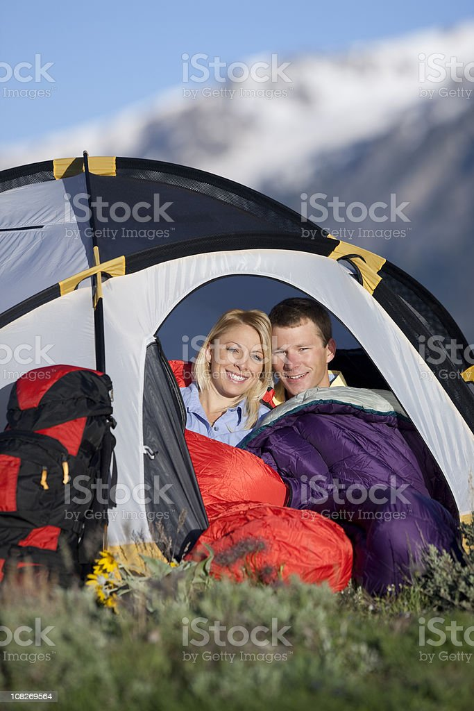 Young Couple Sitting Inside Small Tent In Mountains royalty-free stock photo