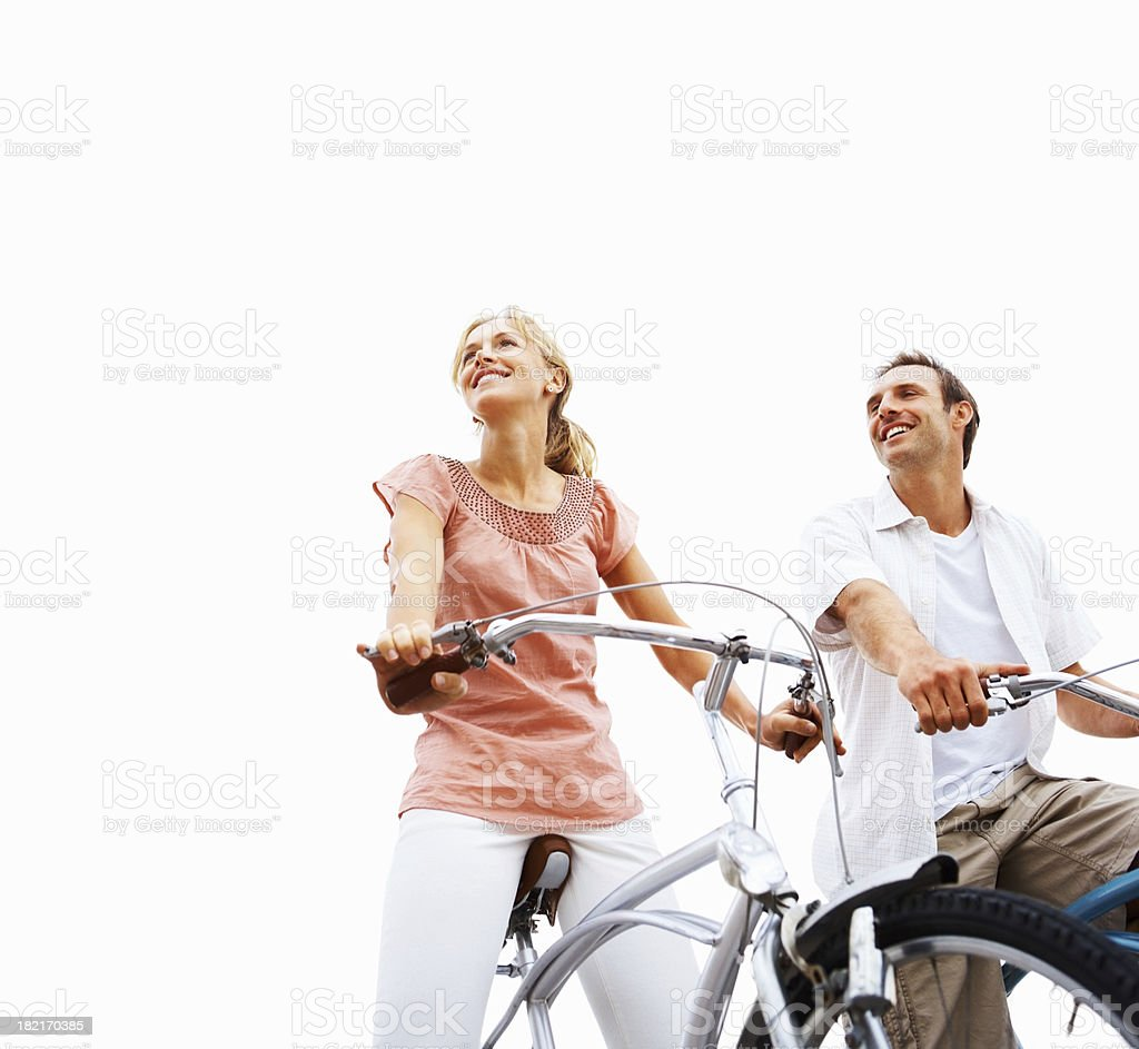 Young couple sitting on bicycles royalty-free stock photo