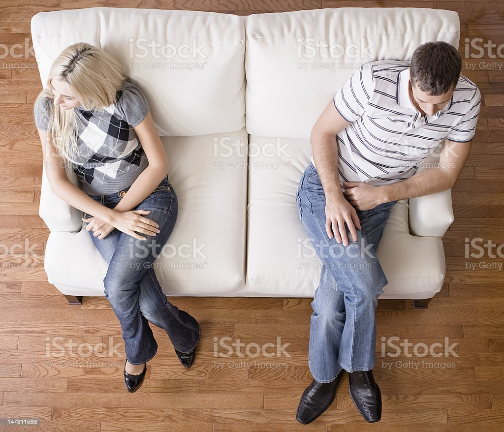 Young Couple Sitting on Love Seat stock photo
