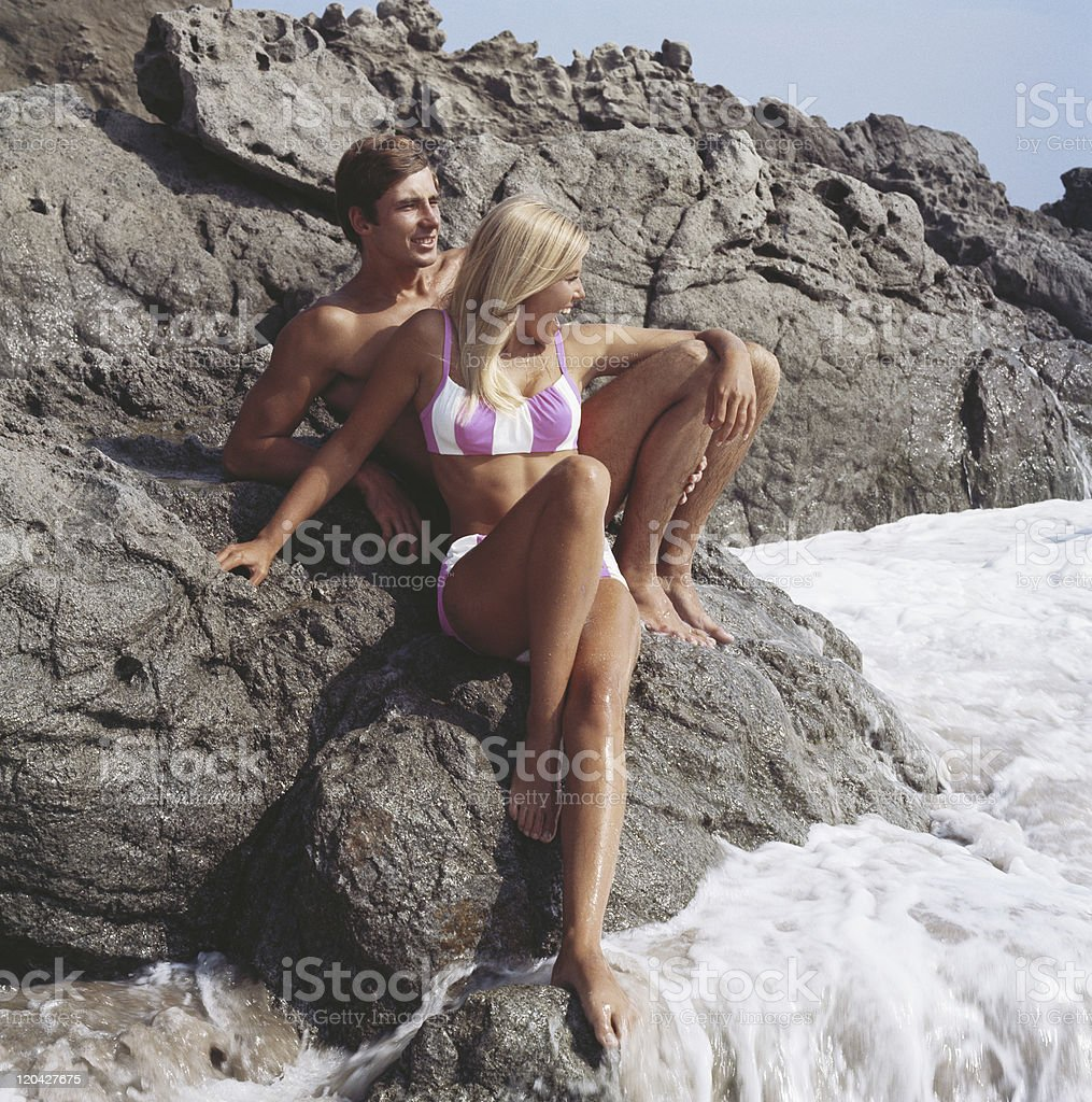 Young couple sitting on rocks royalty-free stock photo