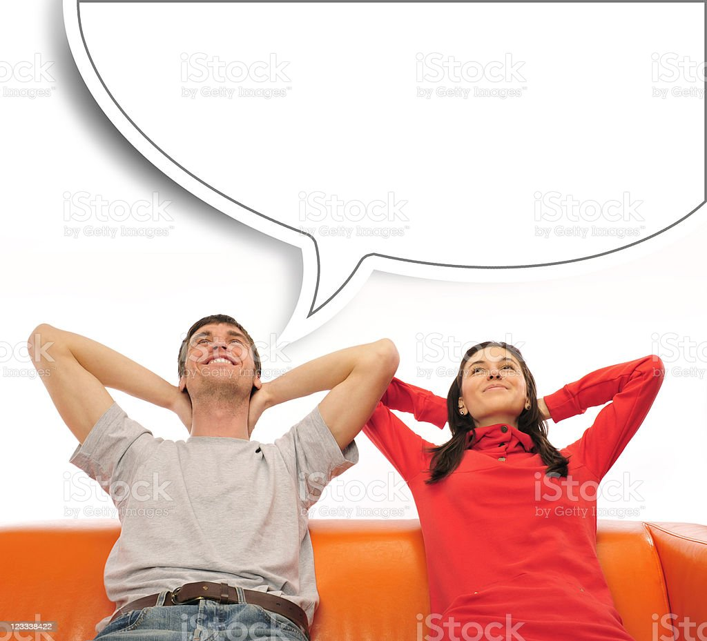Young couple sitting on sofa and dreaming stock photo