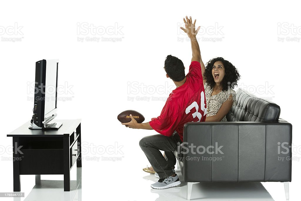 Young couple sitting on sofa royalty-free stock photo