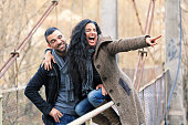 Young couple sitting on the bridge