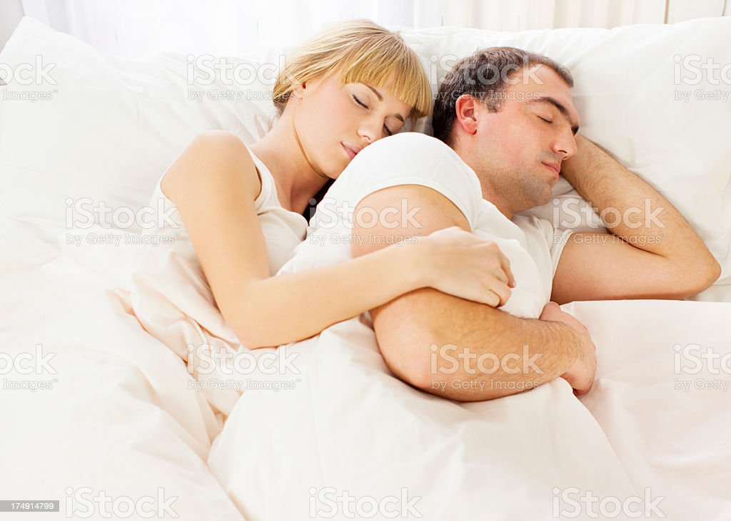 Young Couple Sleeping Face to Back. royalty-free stock photo