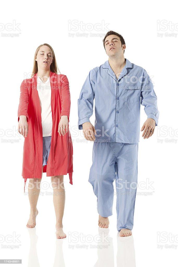 Young couple sleepwalking against white stock photo